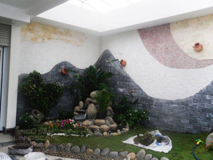 Thiết kế tường ốp đá sân vườn sang trọng